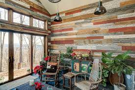 ... Reclaimed wood adorns the walls of this creative, rustic sunroom  [Design: Appalachian Antique