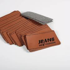 high end debossed or embossed garment pu leather labels for jeans
