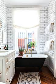 white and brass bathroom. subway tile with gray grout view full ...