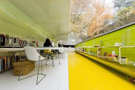Tube office Pneumatic Tube Shares Demilked Glass Office Makes Employees Feel Like Theyre In The Middle Of The