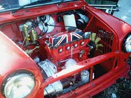 the mini register 2008 all wiring in place the engine can be fitted it takes only about 20 minutes to lower it into place connect the drive shafts engine mounts