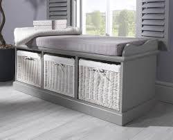 grey storage bench with  white baskets