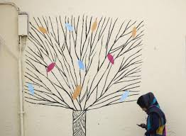 don39t love homeoffice. an woman checks her mobile phone as she walks past graffiti of a tree in central tehran this file photo from 31 december 2014 getty don39t love homeoffice