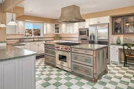 country kitchen with white cabinets green granite counters