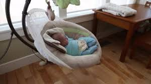 a newborn baby boy in a swing at home Stock Video Footage - Videoblocks
