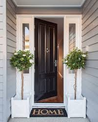 black door and white moldings wele home to this clic htons style front entrance design build decorating image by evermoredesignedhomes