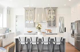 light gray cabinets with seeded glass doors