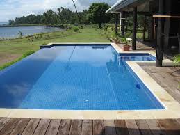 Modern Backyard Landscaping Designs With Wooden Pavers Around Also Cool  Rectangular Pool Also Porch Ideas