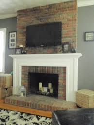 hang tv over fireplace brick ideas