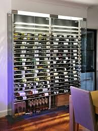 glass enclosed wine cellars are curly one of the hottest trends in the wine cellar industry and what s not to like glass doors and walls provide a