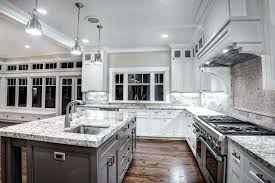 off white kitchen cabinets with dark granite black countertops