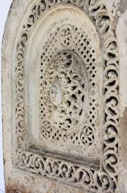 a beautiful antique arched cast iron fireplace cover dating from the 19th century the summer cover features a patera in the center surrounded by a