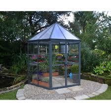 glass greenhouse metal frame in garden
