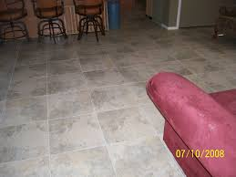 this floor was transformed from old tile to beautiful 24 x 24 inch rectified porcelain tile