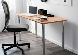 A Light Home Office With A Grey Chair Brown Table Top And Silver Legs Desk  Ikea
