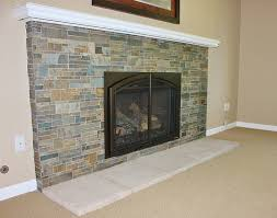 fireplace with slate tile surround and cultured hearthstones