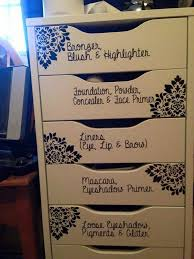 use a vanity to store your make up paint the outside in a neutral color ivory or cream then write in any font or color what each drawer holds awesome diy makeup