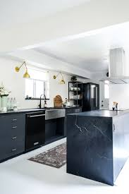 Kirsten Grove's kitchen renovation via simply grove Black soapstone ...