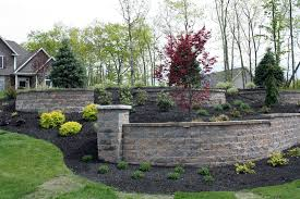 stone retaining wall with plantings