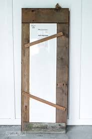 frame an old mirror with barnwood