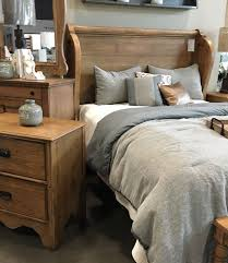 Church pew headboard bed from Magnolia Home by Joanna Gaines At
