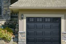 haas model 680 garage door in cool black with coloniial windows