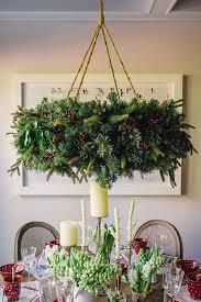 oversized evergreen wreath chandelier with pinecones and berries