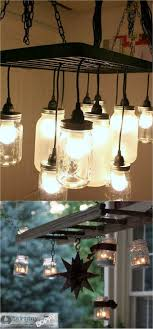 a hanging pot rack to build this mason jar chandelier if you want a simple version beth at unskinny boppy ed a ladder to create an outdoor mason