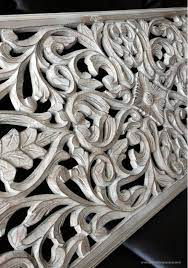 carved wood wall decor white wood paneling