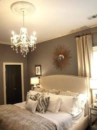 beautiful bedroom design with gray walls paint color crate barrel bed sunburst mirror zebra pillows crystal chandeliers crate and barrel