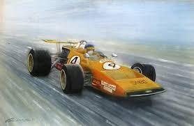 ronnie peterson driving orange formula 1 racing car