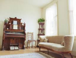 living room antique furniture. This Light, Airy Living Room Is Dominated By The Antique Player Piano In Center Furniture W