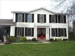 painted white brick red door black shutters and garage
