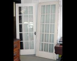 this vintage door is pictured to the right it has 15 panes of original glass 3 over 5 painted both sides good condition 30 1 4 x77 1 3 8 thick