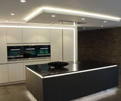 stylish lighting. Decorations:Stylish Kitchen Design With White Ceiling Hidden Lighting And Large Black Island Ideas Stylish