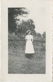 Nurse, Elaine Howell, Standing in Front of a Garden - Lucius ...