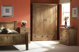 Rustic Oak Bedroom Furniture Sets In A Red Walled Room
