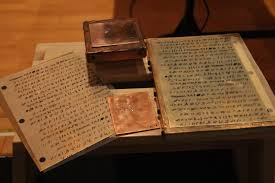 display shows materials gordon andrus used to press printed book of mormon characters onto metal plates after he had laster printed them onto plastic