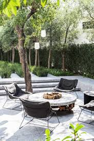 patio with modern lounge chairs around fire pit on thou swell thouswellblog