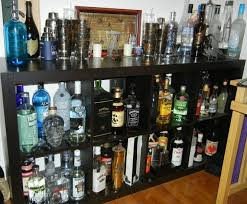 contemporary home bar with glowing slapsticker wine bottle labels and ikea best liquor cabinet