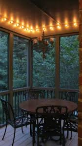 screened porch outlined with globe string lights