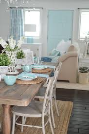 an eclectic blend of cote farmhouse style with vine finds and junque favorites summer farm table decorating ideas with coastal touches