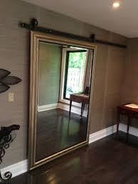 sliding barn door with a mirror for hiding a walk in closet
