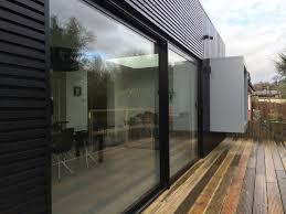 black aluminium sliding patio doors and windows