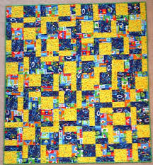 Youth Size Quilts for Sale & Youth/Lap Size 52 x 58. This quilt is made with cute Alien fabrics, with  flying saucers, aliens, and stars. It has a green