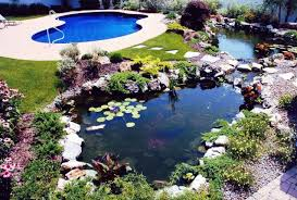 two round backyard koi pond ideas mixed with stone edge placement and beautiful flowers garden and stone footpath also unusual pool with white lounge chair
