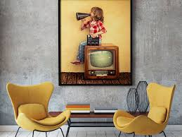 the mockup shows a poster hanging on a wall in a modern living room
