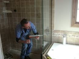 understanding installation and labor costs contractor installs shower in small bathroom