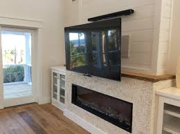 Over The Fireplace Tv Cabinet Not Yet Finished Mantlemount In Down Position Tv Over Linear