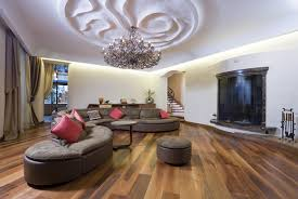 living room with hanging chandelier ceiling design
